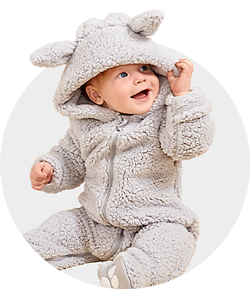 Baby Wearing Grey Bunny Coveralls