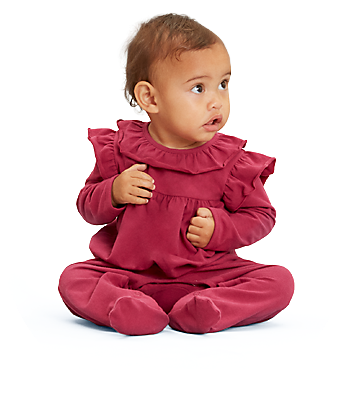 Baby wearing rose red coverall