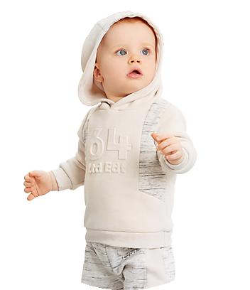 Baby wearing white hoodie
