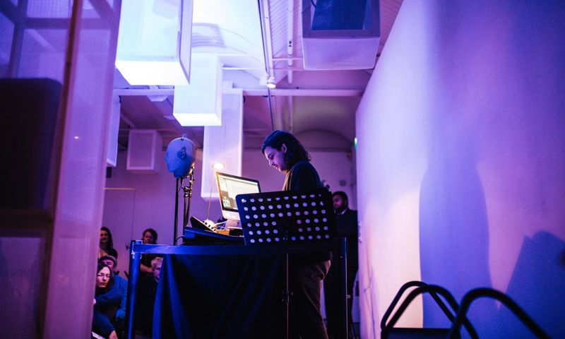 Student performing with turntable and computer