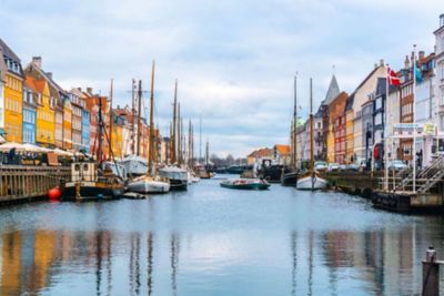 Photograph of Denmark's canal and buildings.