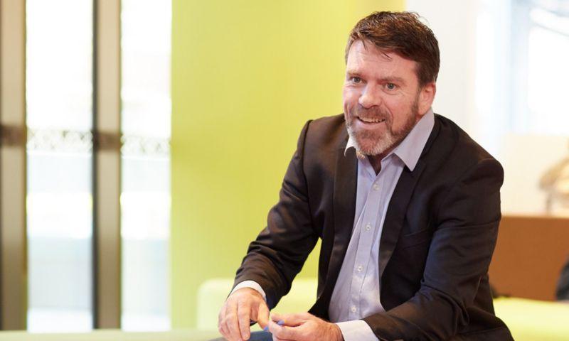 Steven Kennedy - business man smiling in office
