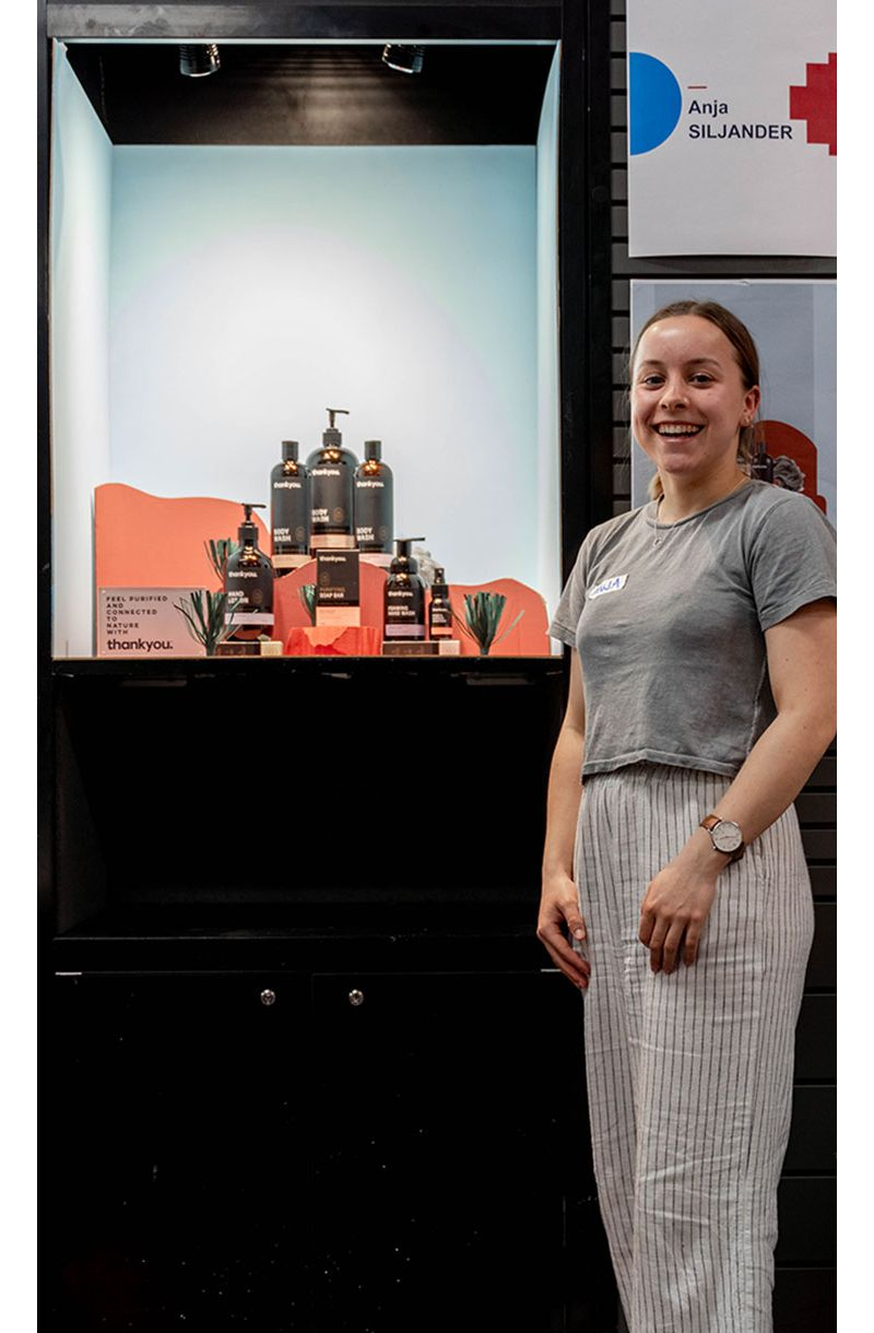 Anja Siljander stands in front of her visual merchandising display at the Regional WorldSkills Visual Merchandising competition 2019.