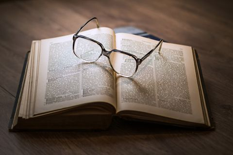 Glasses on book. Knowledge.