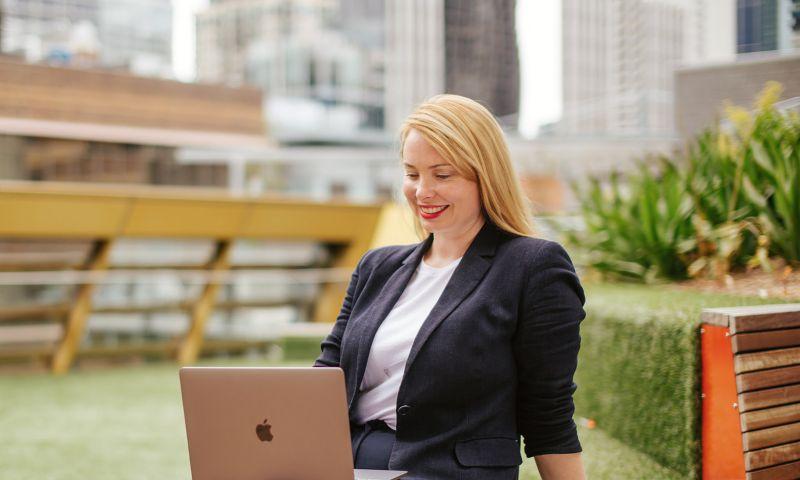 Woman on laptop in an RMIT Rooftop garden