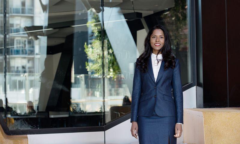 Hema Zmirak - Smiling woman in a corporate suit