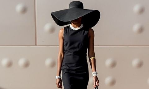 woman in black dress and hat