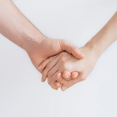 Isolate of 2 hands being held on a white background