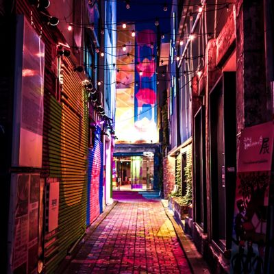 Bright alleyway photographed at night.