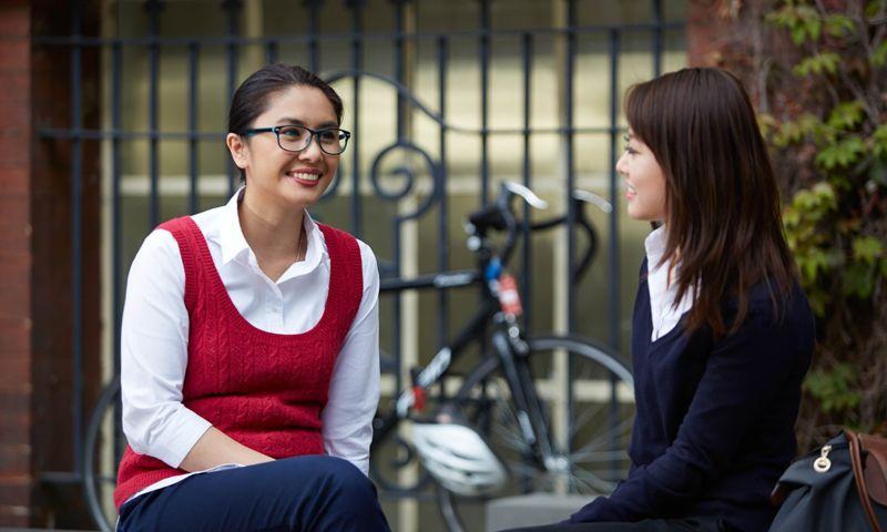 Two women in conversation.