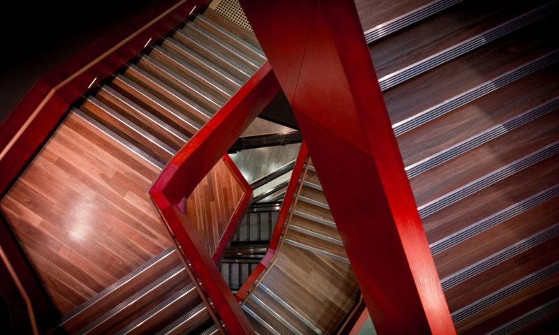 Red and wooden staircase viewed from above