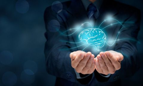 Hands holding abstract image of brain