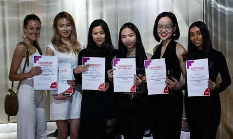 VE Fashion students stand with their Teamwork recognition awards at the end of year ceremony