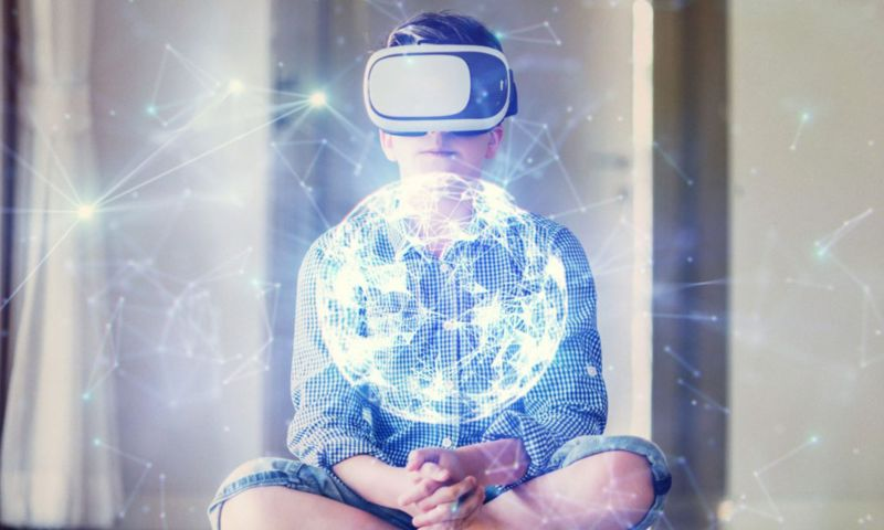 Child wearing virtual reality headset with abstract bright globe image overlay