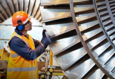 Man working on a jet engine