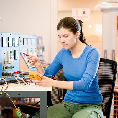 Woman testing wires.